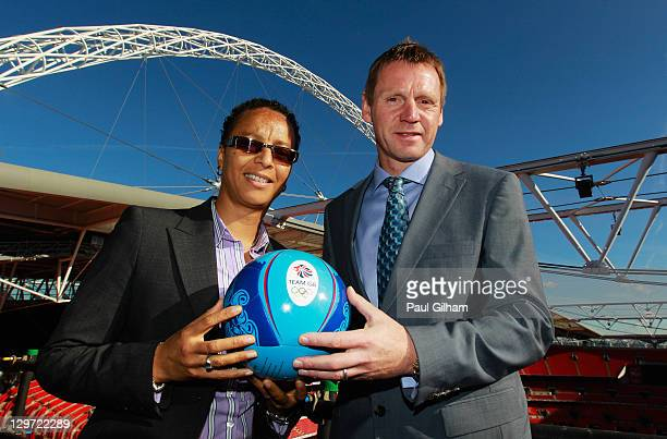 Hope Powell and Stuart Pearce pose together following a press conference to announce the Men's and Women's Football Team managers of Great Britain...