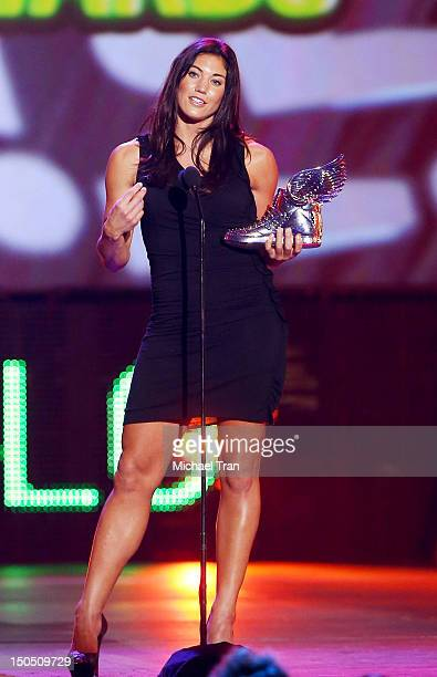 Hope Solo accepts award onstage at VH1's 2012 Do Something Awards held at Barker Hangar on August 19 2012 in Santa Monica California