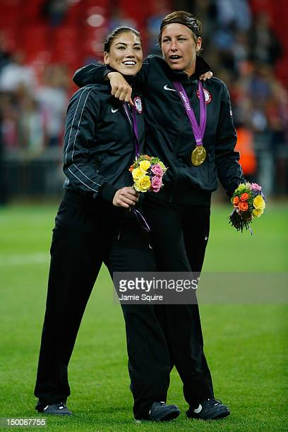 Hope Solo and Abby Wambach of the United States celebrate with the the gold medal after defeating Japan by a score of 21 to win the Women's Football...