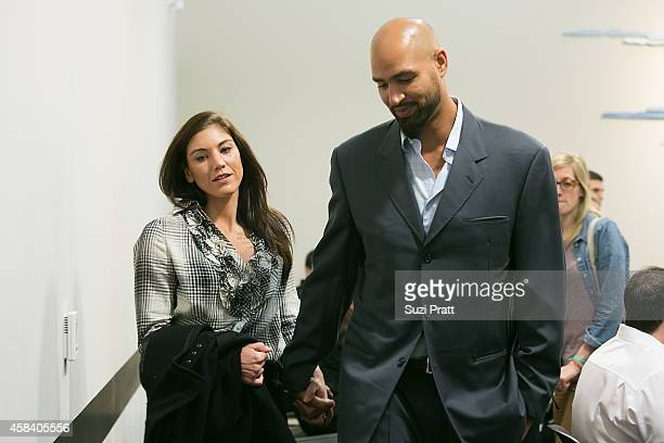 Hope Solo and husband Jerramy Stevens exit the court room at Kirkland Municipal Court on November 4 2014 in Kirkland Washington Solo is charged with...