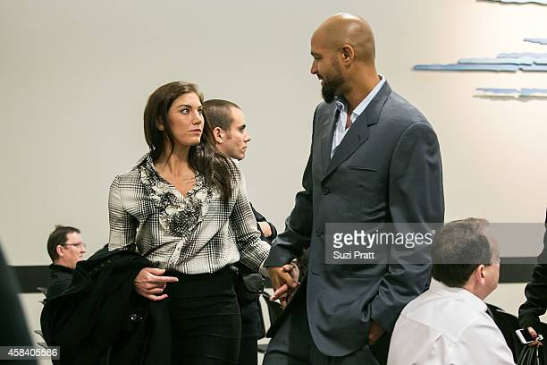 Hope Solo and husband Jerramy Stevens exit the court room at Kirkland Municipal Court on November 4, 2014 in Kirkland, Washington. Solo is charged...