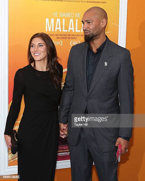 """Hope Solo and Jerramy Stevens attend the """"He Named Me Malala"""" premiere at Ziegfeld Theater on September 24, 2015 in New York City."""