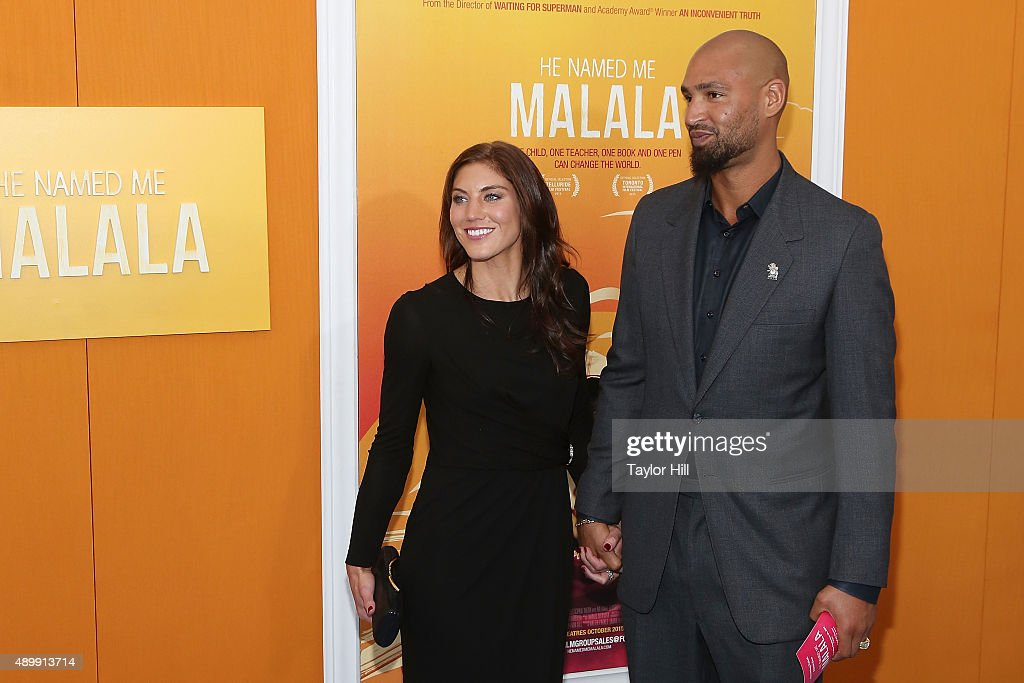 Hope Solo and Jerramy Stevens attend the 'He Named Me Malala' premiere at Ziegfeld Theater on September 24, 2015 in New York City.