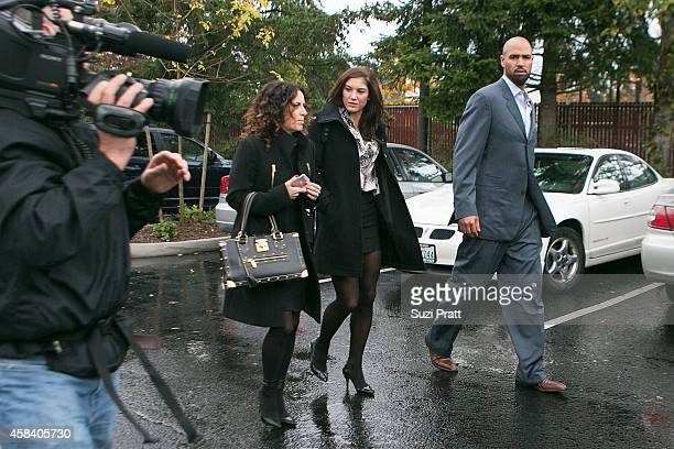 Hope Solo and Jerramy Stevens leave the court house at Kirkland Municipal Court on November 4, 2014 in Kirkland, Washington. Solo is charged with...