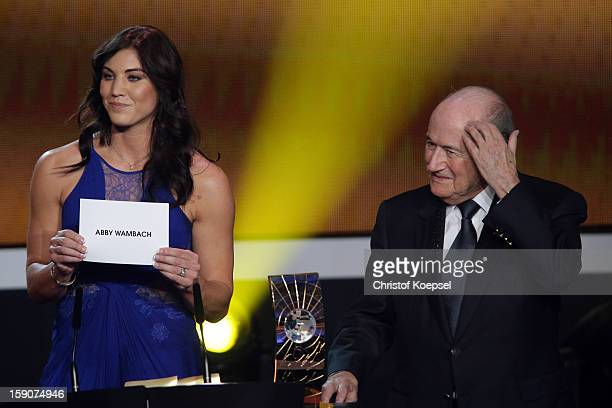 Hope Solo and Joseph Blatter FIFA president announce Abby Wambach of United States as the winner of the FIFA womens player of the year trophy during...