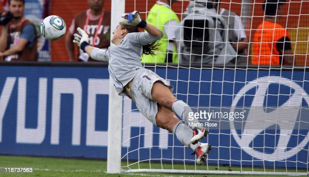 Hope Solo, goalkeeper of USA saves a penalty during penalty shoot out during the FIFA Women's World Cup 2011 Quarter Final match between Brazil and...
