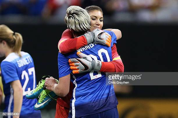Hope Solo hugs Abby Wambach of the United States during the women's soccer match against China at the MercedesBenz Superdome on December 16 2015 in...