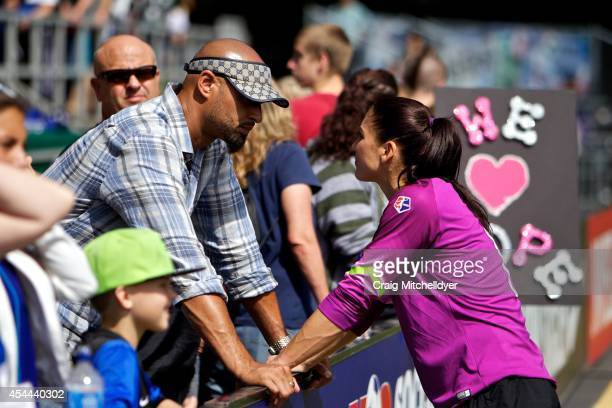 Hope Solo of Seattle Reign FC talks to her husband Jerramy Stevens after the 21 loss in the National Women's Soccer League Championship on August 31...