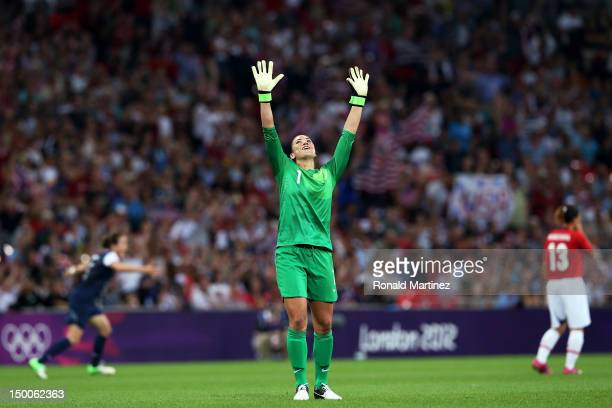 Hope Solo of the United States celebrates after defeating Japan by a score of 2-1 to win the Women's Football gold medal match on Day 13 of the...