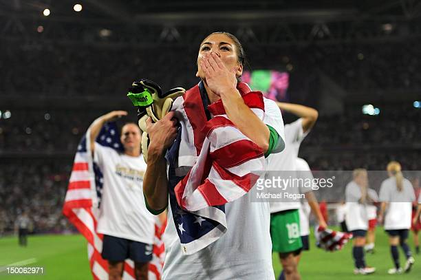 Hope Solo of the United States celebrates with the American flag after defeating Japan by a score of 21 to win the Women's Football gold medal match...