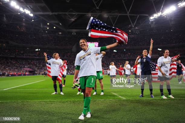Hope Solo of the United States celebrates with the Amrican flag after defeating Japan by a score of 2-1 to win the Women's Football gold medal match...