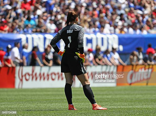 Hope Solo of the United States follows the action as she posts her100th career shutout against South Africa in a friendly match at Soldier Field on...
