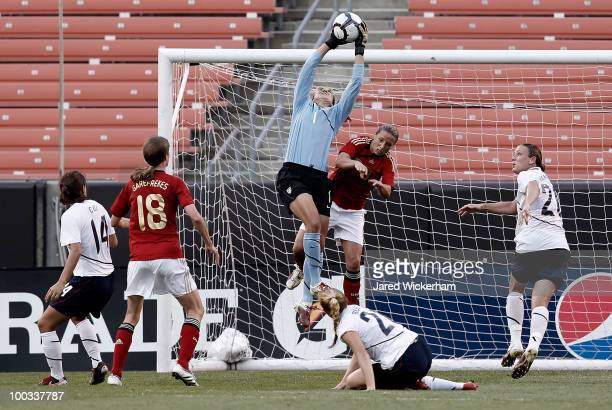 Hope Solo of the United States makes a save in front of Inka Grings of Germany during the game on May 22 2010 at Browns Stadium in Cleveland Ohio