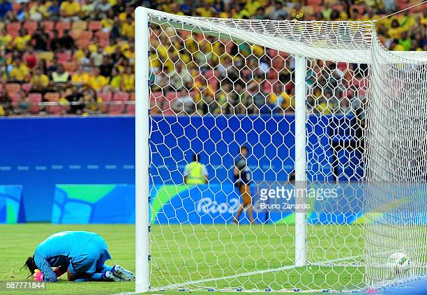 Hope Solo of the United States reacts after Angela Clavijo of Colombia scored a goal past her in the first half of the Women's Football First Round...
