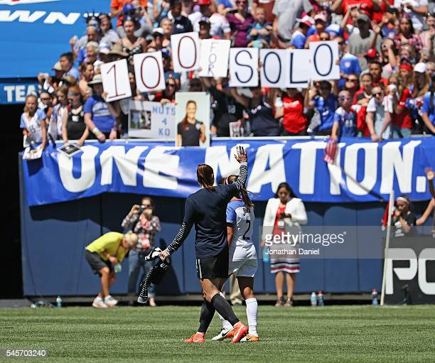 Hope Solo of the United States waves to the crowd after posting her100th career shut-out against South Africa after a friendly match at Soldier Field...