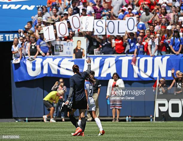 Hope Solo of the United States waves to the crowd after posting her100th career shutout against South Africa after a friendly match at Soldier Field...