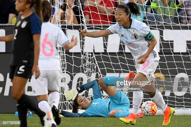 Hope Solo of US Women's National Team lies on the turf after giving up a goal to Yuki Ogimi of Japan during the first half of action of their 33 tie...