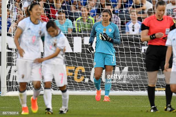 Hope Solo of US Women's National Team reacts to giving up a goal to Yuki Ogimi of Japan as she celebrates with Emi Nakajima during the first half of...