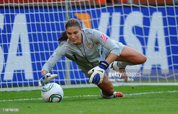 Hope Solo of USA makes a save during the FIFA Women's World Cup 2011 Quarter Final between Brazil and USA at the Rudolf Harbig Stadium on July 10...