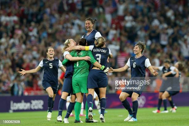 Hope Solo Shannon Boxx and Christie Rampone Amy LePeilbet Kelley O'Hara of the United States celebrates after defeating Japan by a score of 21 to win...