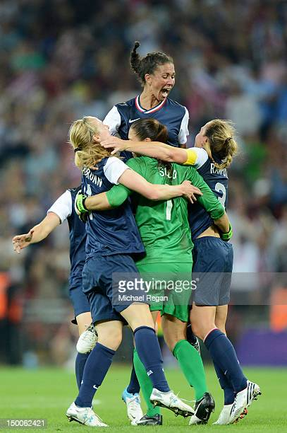 Hope Solo Shannon Boxx and Christie Rampone of the United States celebrates after defeating Japan by a score of 21 to win the Women's Football gold...