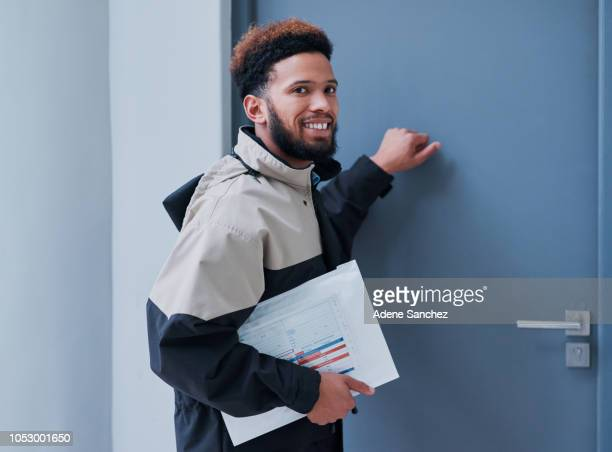i hope the customer's here to do my delivery - knocking on door stock photos and pictures