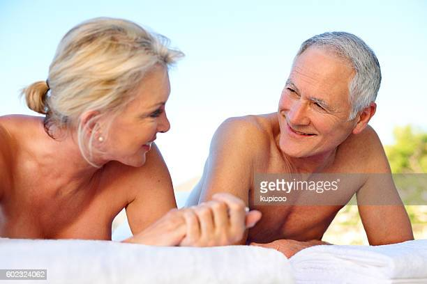 i hope this holiday never ends - husband massage wife stock photos and pictures