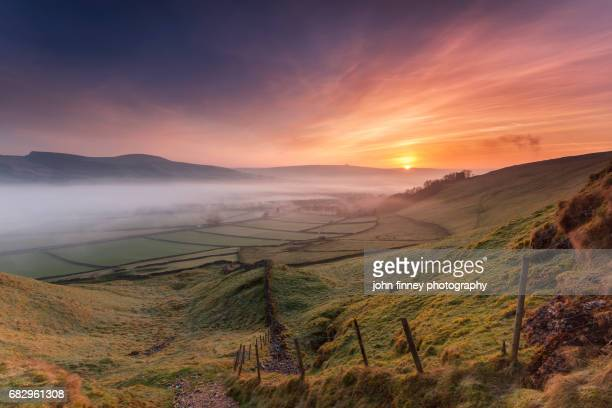 hope valley sunrise with castleton's fort and village. english peak district. uk. - peak district national park stock pictures, royalty-free photos & images