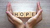 Hope word made by female hands, family creation, expectancy of baby, happiness