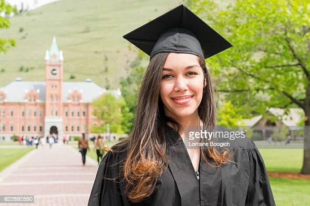 Hopeful American Hispanic Woman in 20s Celebrating Graduation Day