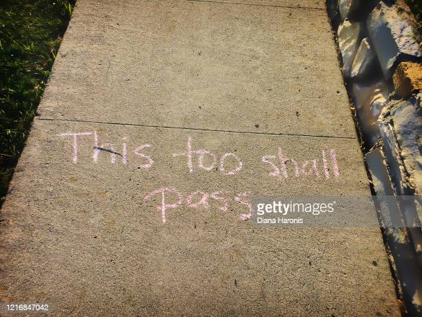 """hopeful message on sidewalk """"this too shall pass"""" - stay at home order stock pictures, royalty-free photos & images"""