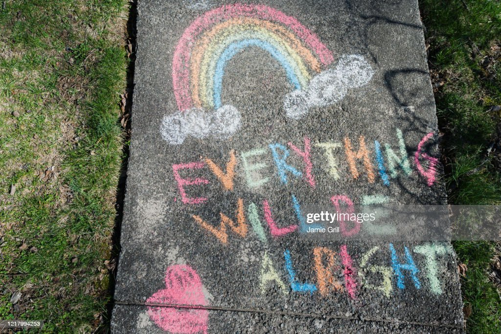 Hopeful message written on sidewalk in chalk during Covid 19 pandemic : Stock Photo