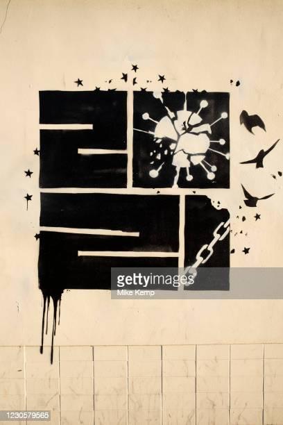 Hopeful piece of graffiti street art offering hope that the shackles of the coronavirus will be broken in 2021, during the third national coronavirus...