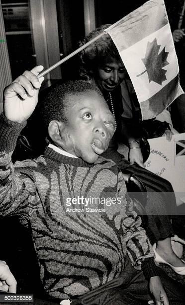 Hopeton Edwards Jamaican boy born with neurofibromatosis waves Canadian flag upon arrival in Metro last night