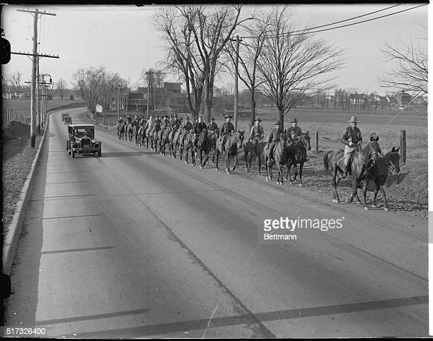 Horsemen of the 112th Field artillery as they filed along the road on their way to search the Sourland Mountain district for any trace of the...