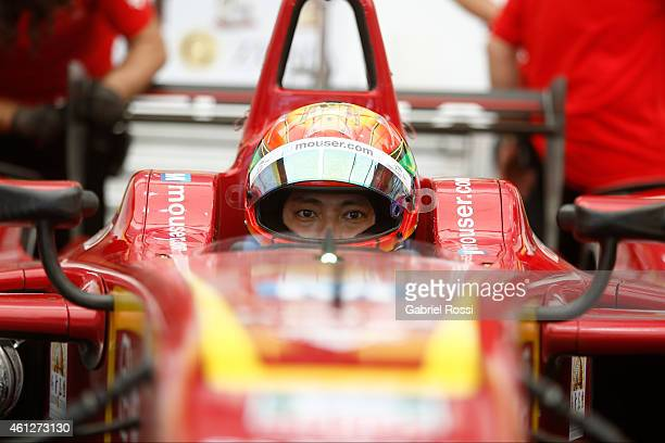 HoPin Tung of China and China Racing Formula E Team waits in boxes during a nonqualifying practice as part of 2015 FIA Formula E Buenos ePrix at...