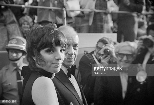 Hoping for an Oscar. Hollywood, Calif.: Actress Liza Minnelli arrives here with her father Vincente Minnelli to attend the Academy Awards ceremonies....