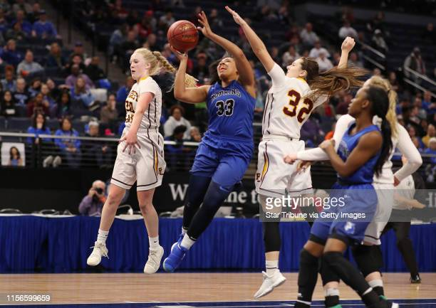 Hopkins Dlayla Chakolis scored over Forest Lake Abigail Groeneweg left and Kenzie Stumne during girls class 4A quarter final action at Target Center...