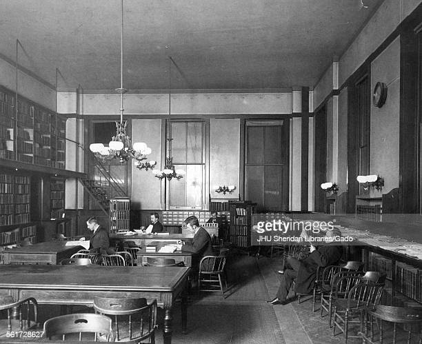 Hopkins Hall, Old Campus, Library, Old Campus interior, Library, with students reading, Johns Hopkins University, Baltimore, Maryland, 1885.