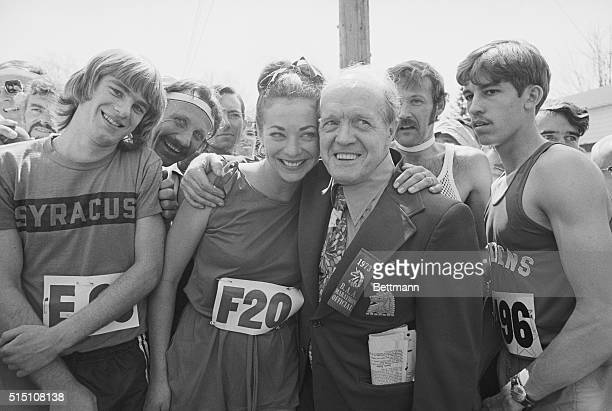 Jock Semple BAA Boston Marathon official who for years was against women running in the famous Boston Marathon poses with pretty Katherine Switzer a...