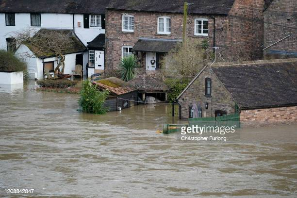 Hopmes are flooded in Ironbridge after the River Severn burst it's banks on February 26, 2020 in Ironbridge, England. Shrewsbury, Worcester and...
