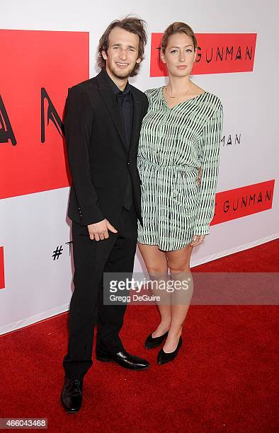 Hopper Penn and Uma Von Wittkamp arrive at the Los Angeles premiere of The Gunman at Regal Cinemas LA Live on March 12 2015 in Los Angeles California