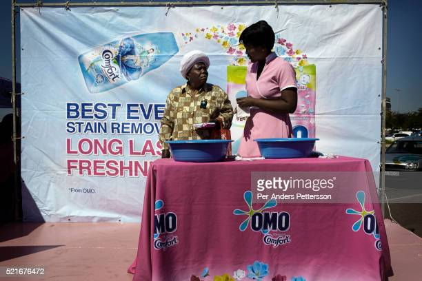 hoppers attend a promotion for a detergent brand on May 1 2013 at Maponya shopping Mall Soweto South Africa Maponya is one of several new shopping...