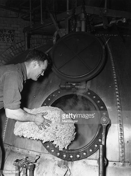 Hops being boiled in a vat to create beer at the Whitbread brewery on Chiswell Street in the City of London 1947
