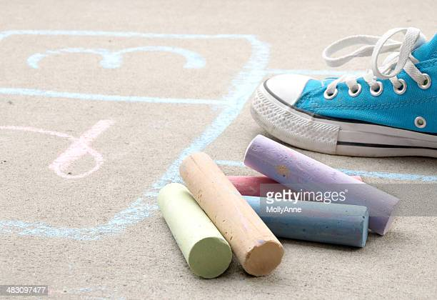 hopscotch and sidewalk chalk on cement - hopscotch stock pictures, royalty-free photos & images