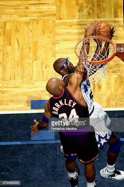 Horace Grant of the Orlando Magic shoots against Charles Barkley of the Phoenix Suns on March 21 1995 at the Amway Arena in Orlando Florida NOTE TO...