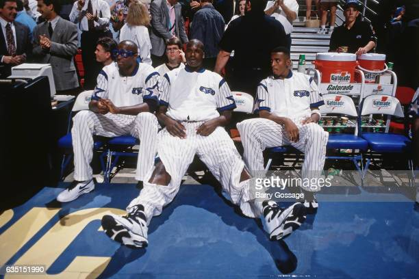 Horace Grant Shaquille O'Neal and Anfernee Hardaway of the Orlando Magic looks on against the Denver Nuggets on December 14 1994 at the Orlando Arena...