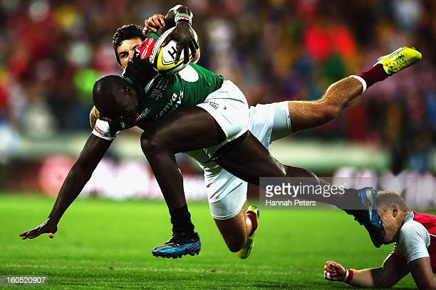 Horace Otieno of Kenya makes a break during the grand final between England and Kenya during the 2013 Wellington Sevens at Westpac Stadium on...