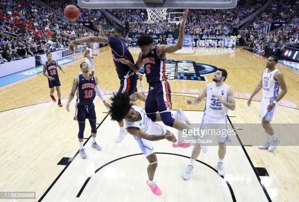 Horace Spencer and Chuma Okeke of the Auburn Tigers block a shot by Coby White of the North Carolina Tar Heels during the 2019 NCAA Basketball...