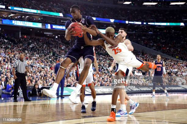 Horace Spencer of the Auburn Tigers battles for the ball with Mamadi Diakite of the Virginia Cavaliers in the first half during the 2019 NCAA Final...